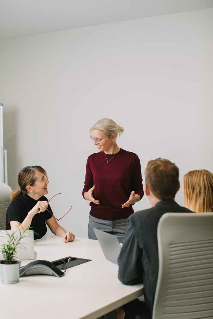 Business coach presenting in boardroom during personal brand session